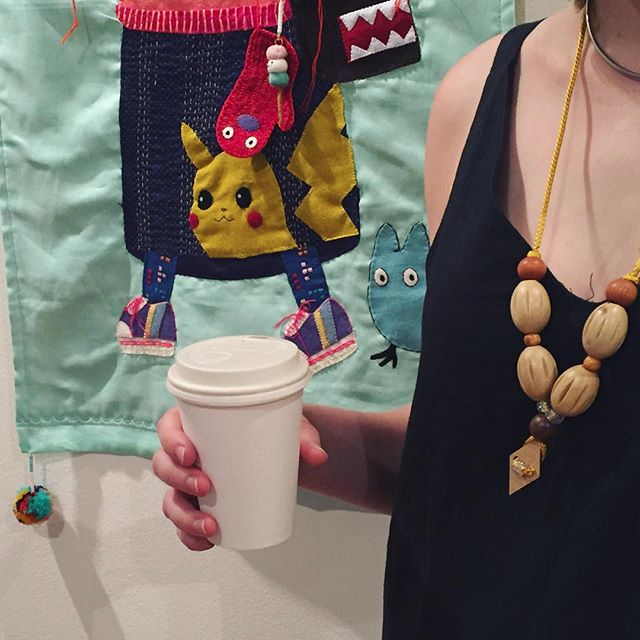 Necklace made and worn by workshop participant. Artwork in background by Cat Rabbit