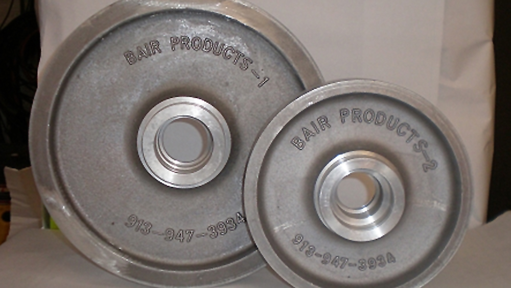 Front Idler Wheels - Heavy Duty Aluminum Alloy Front and Rear Idler Wheels that has INCREDIBLE Wear Life compared to plastic wheels. Reduced wear means longer life for drive lugs as well. Fits CAT 247/257, RC 50/60 or similar machine.READ MORE
