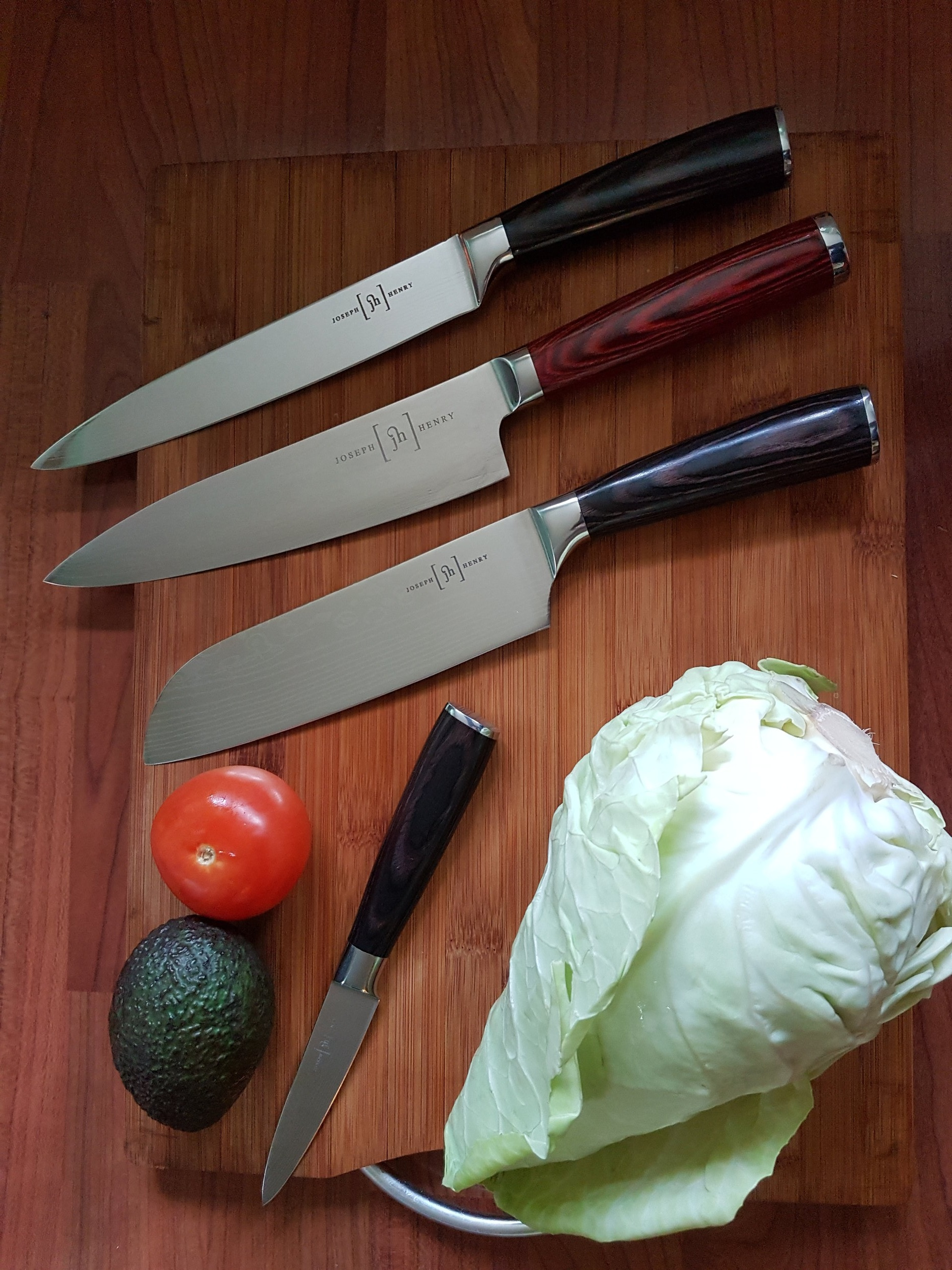 collection of chef knives, carving, gyuto, santoku and paring knife