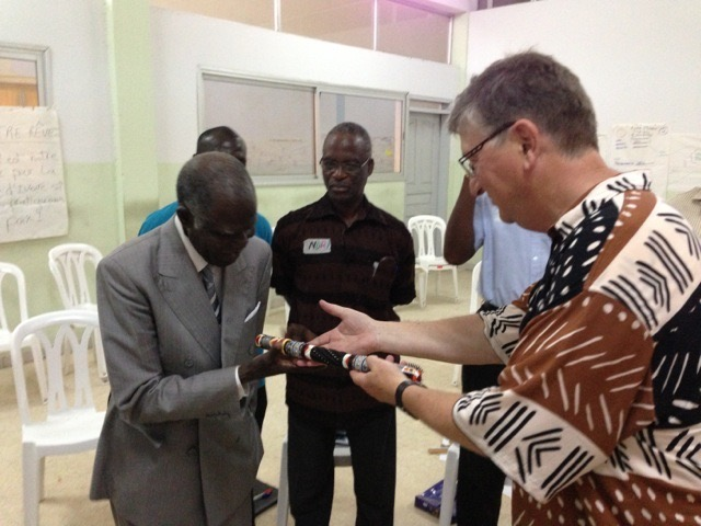 Offering a listening piece to an elder and peace practitioner in Abidjan, Ivory Coast, West Africa in 2013 during the training of 30 practitioners in the art of hosting conversations for building peace after the civil war in Cote D'ivoire - in respect for him calling for help.