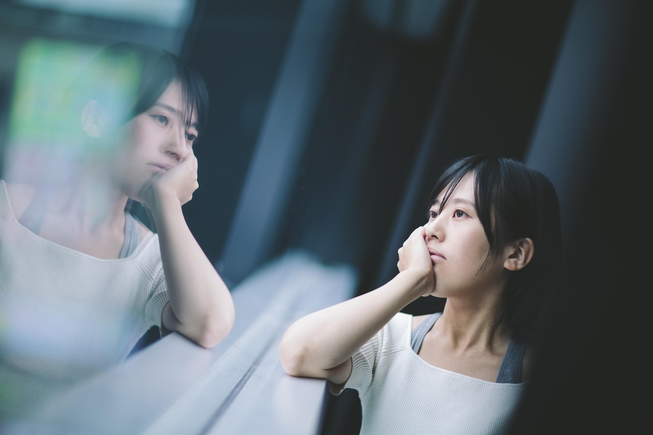anxious asian woman in window.jpg