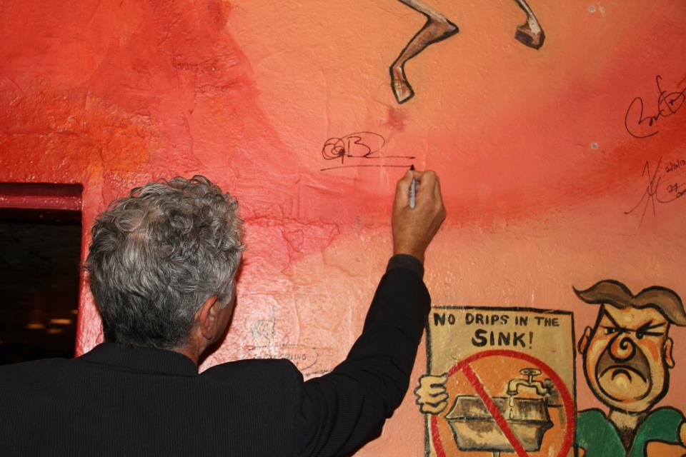 Anthony Bourdain signs The Sink's wall of fame