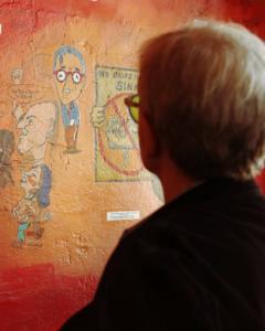 Chuck Morris looks at his new caricature. Photo Credit: Teresa Taylor