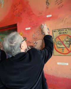Chuck Morris signs the Wall of Fame. Photo Credit: Teresa Taylor