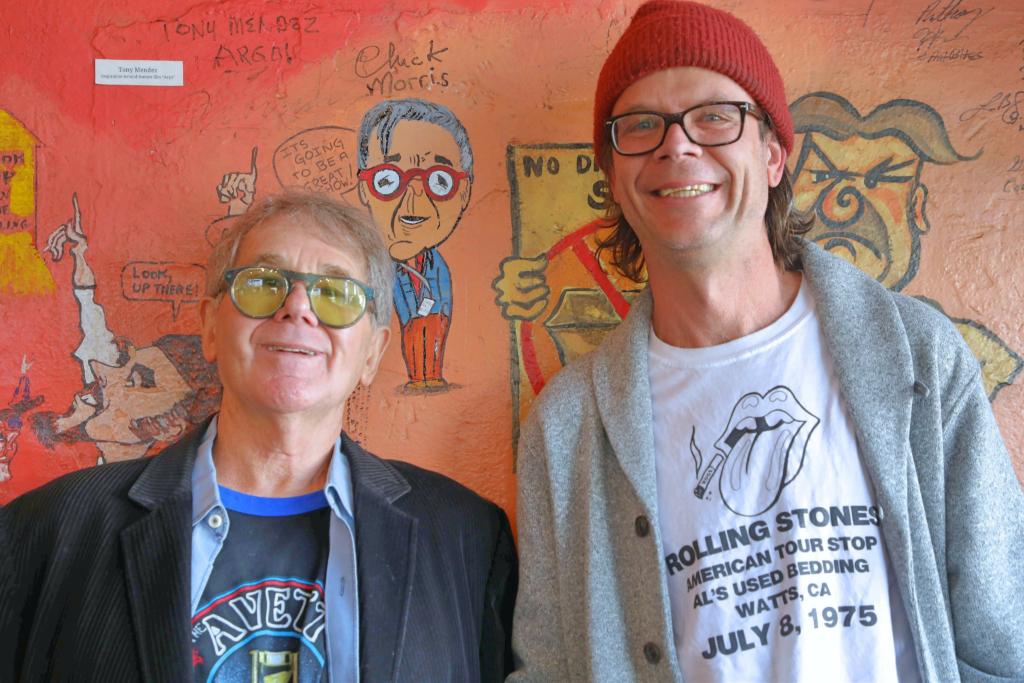 Chuck poses with the artist, Sean Bailey. Photo Credit: Teresa Taylor