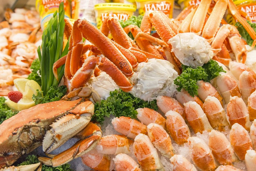 A picture of King crab, Dungeness crab, stone crab claws from our fish monger