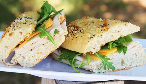 A delicious Turkey, chedder and Arugula Panini from the Vintage Grocers Deli.jpg