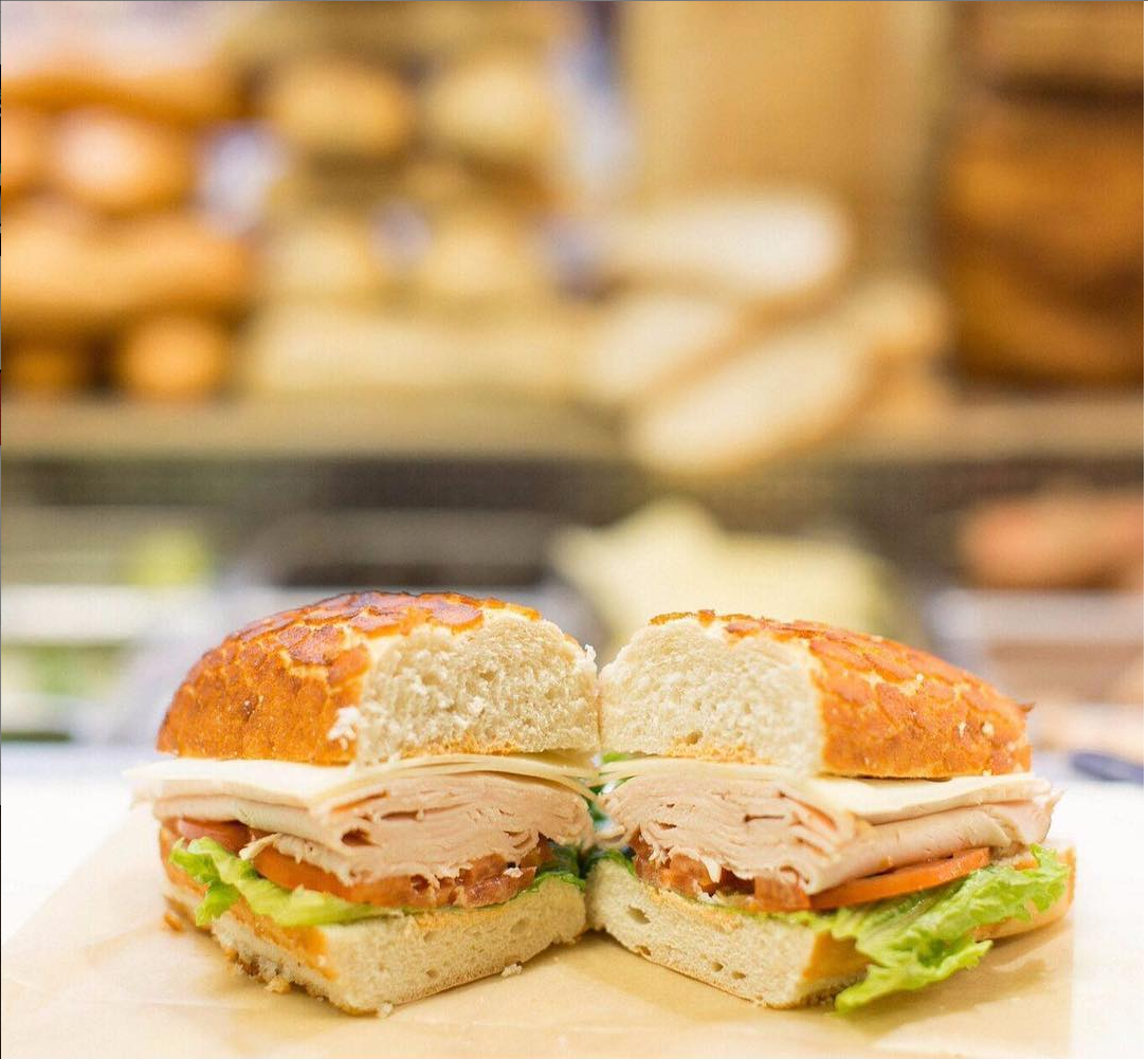 A picture of a Turkey, lettuce and tomatoe sandwhich from our deli.png