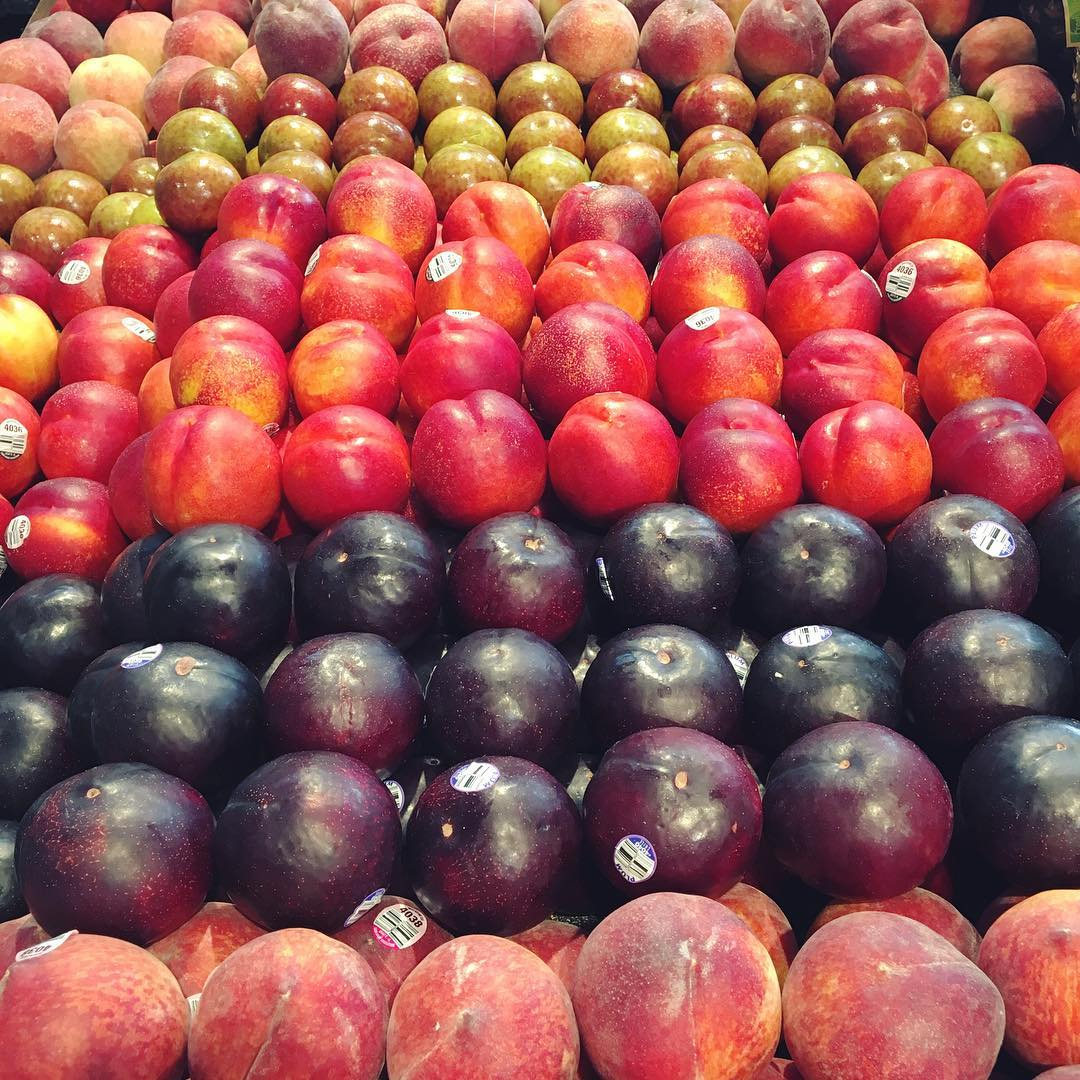 A picture of appricots, plumbs, peaches and pluots on display.jpg