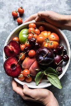 two hands holding bowl of fruit.jpg