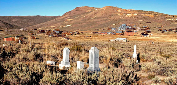 Bodie's cemeteries overlook the townsite. The original cemetery was on waterlogged flatlands and was relocated to the present site in the 1870's. Professional conservators are straightening and restoring some of the grave markers.