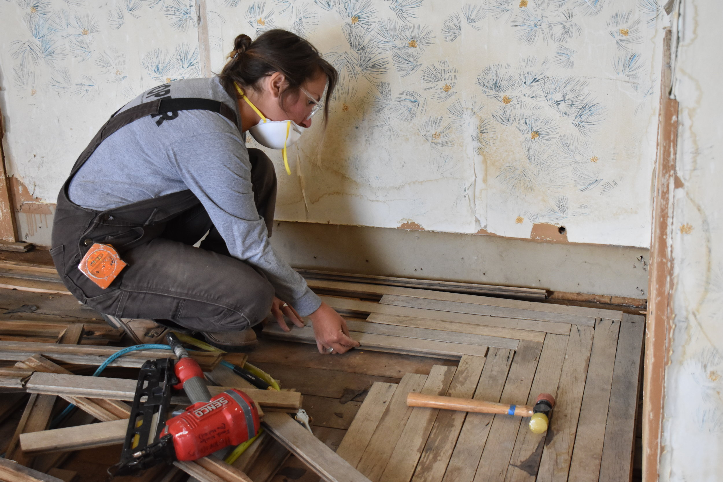 Molly Greenhouse, crew leader from HistoriCorps, works inside the Bodie Railway Office replacing original pieces of the oak flooring during 2019. Photo by Chris Spiller