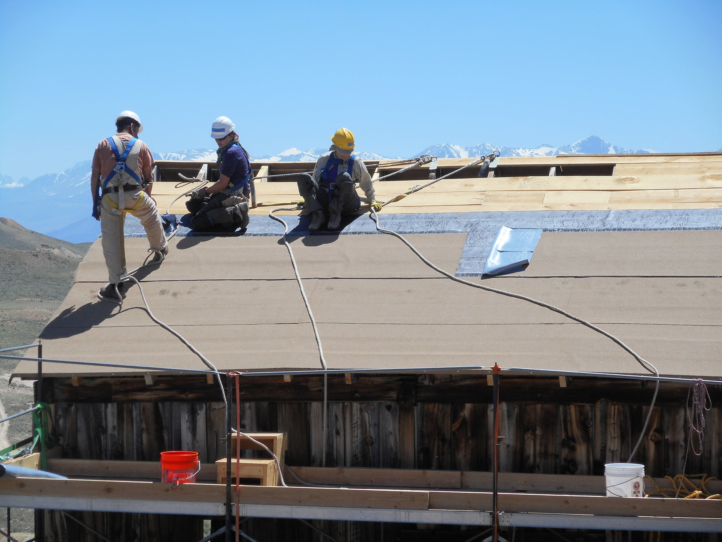 In 2018, Bodie Foundation funded workers from the non-profit HistoriCorps to repair the roof of the Standard Mining Company's hoisting works building. Photo by Brad Sturdivant