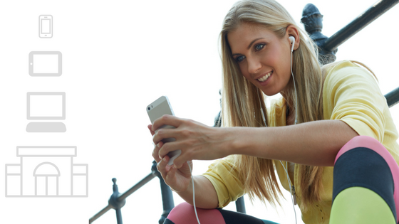Woman smiling while viewing media on her iphone
