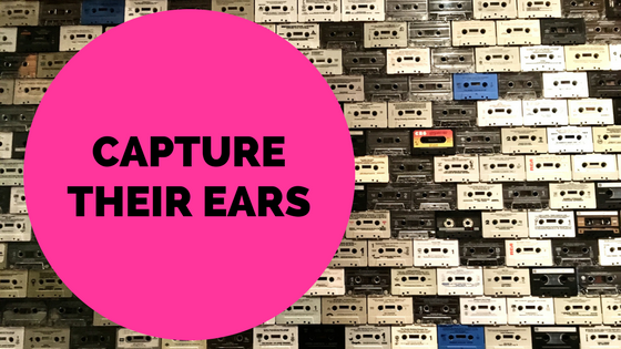"photo of an array of cassette tapes with text overlay ""capture their ears"""