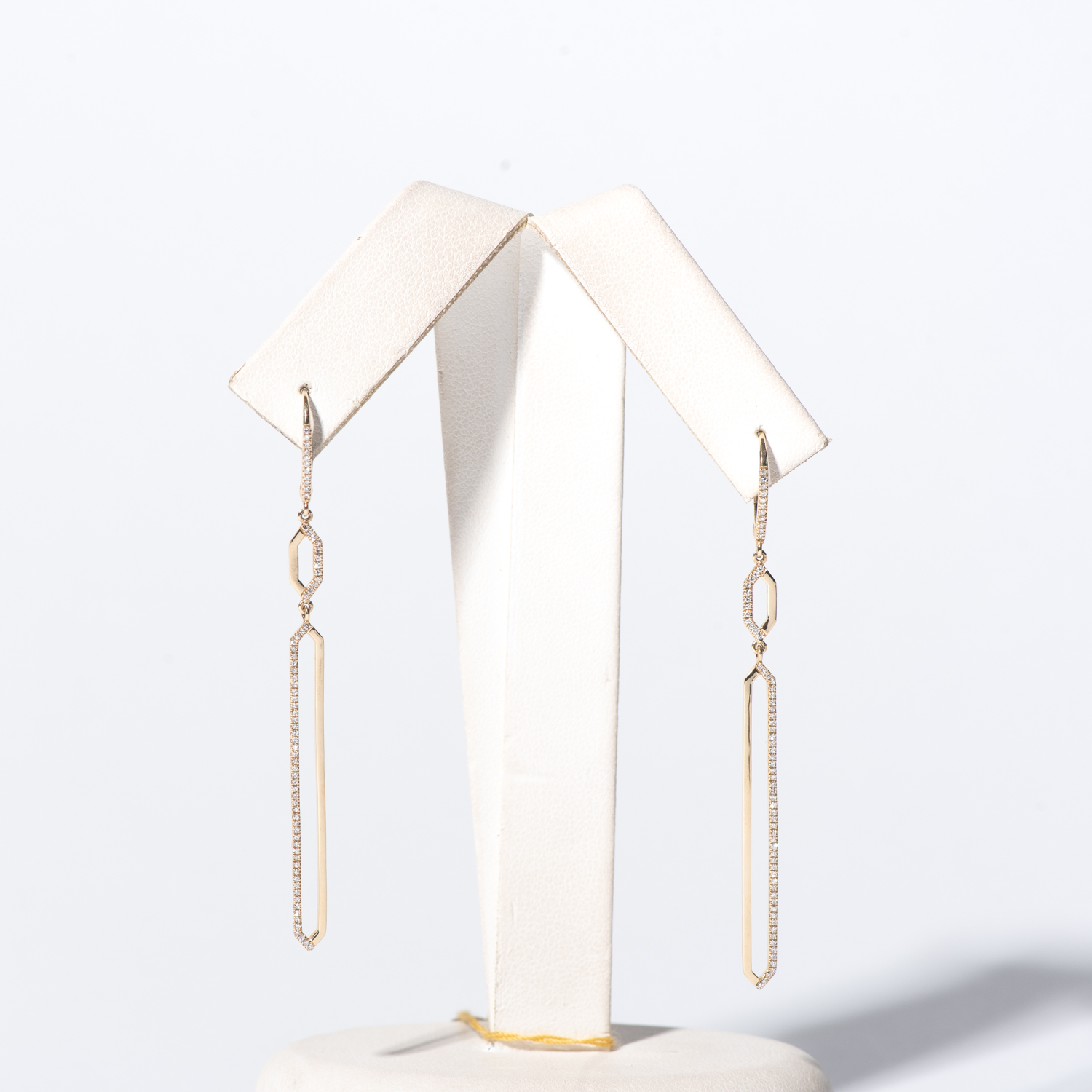 Design Three. - This is dummy text to describe the earrings.