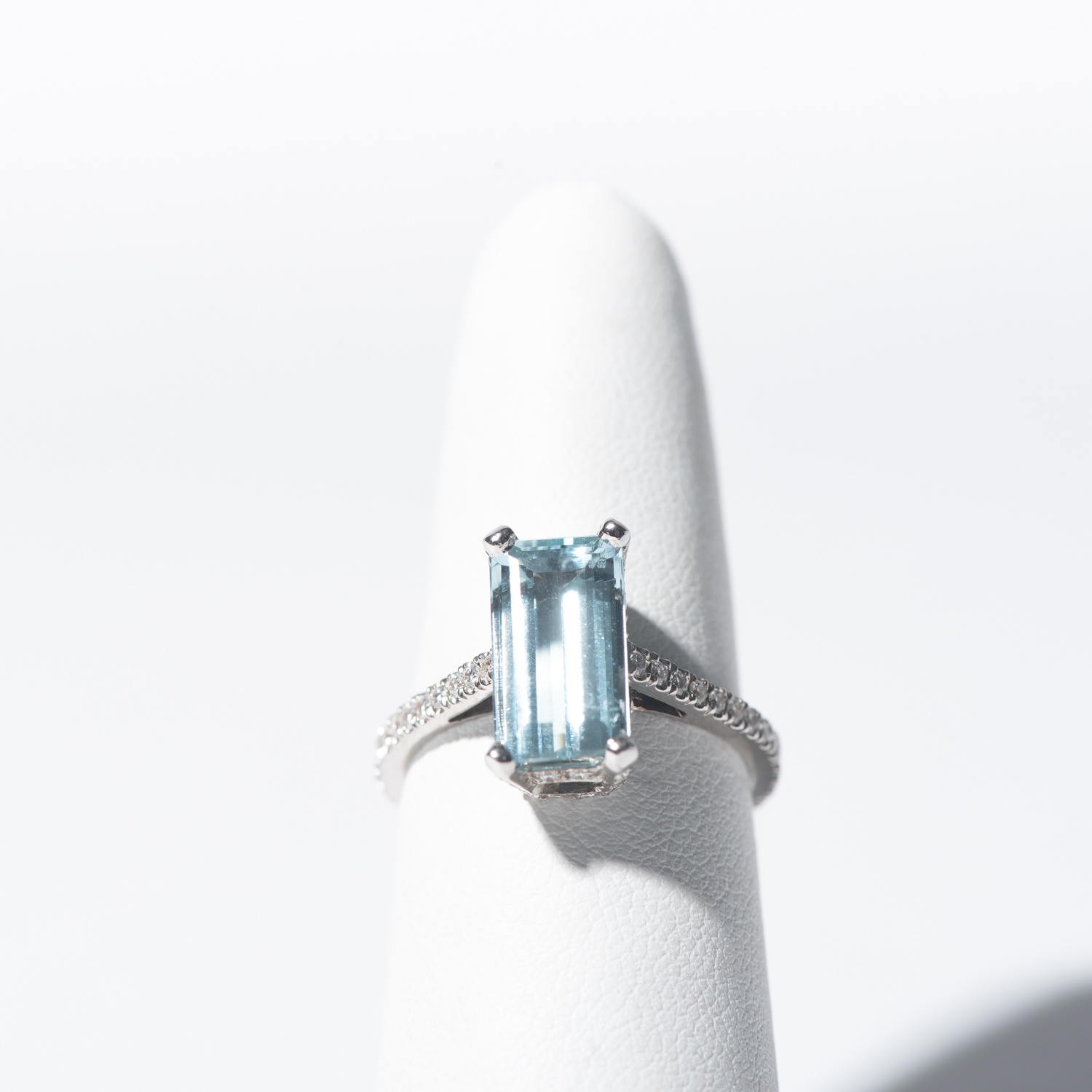 Design Fourteen. - 14K White Gold Aquamarine and Diamond Ring with Diamonds set throughout Wire Basket Setting.