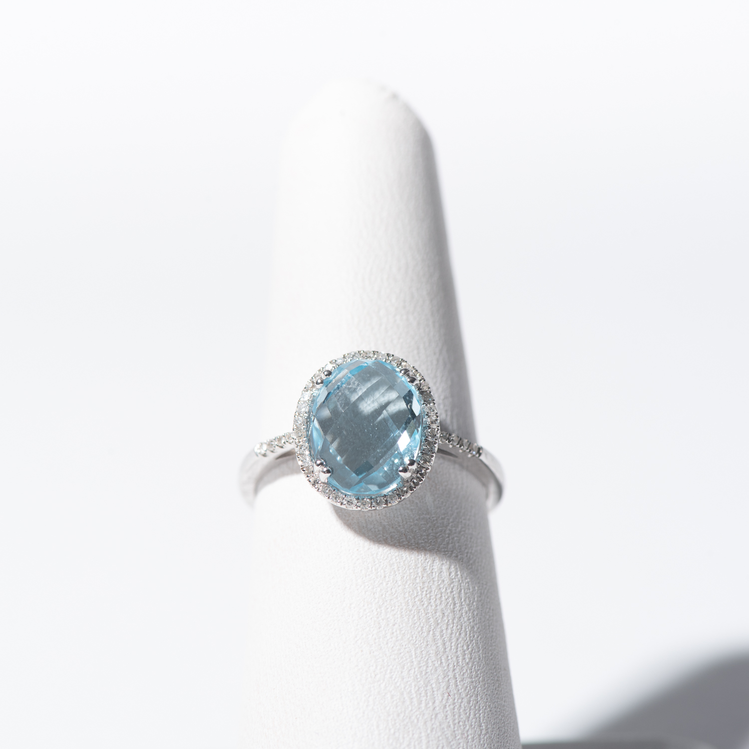 Design Fifteen. - 14K White Gold Blue Topaz with Diamond Halo and Accents