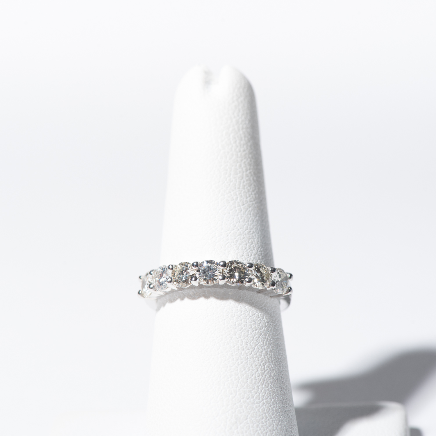 Design Thirty Three.  - Wedding Band Sample - Shared Prong Setting