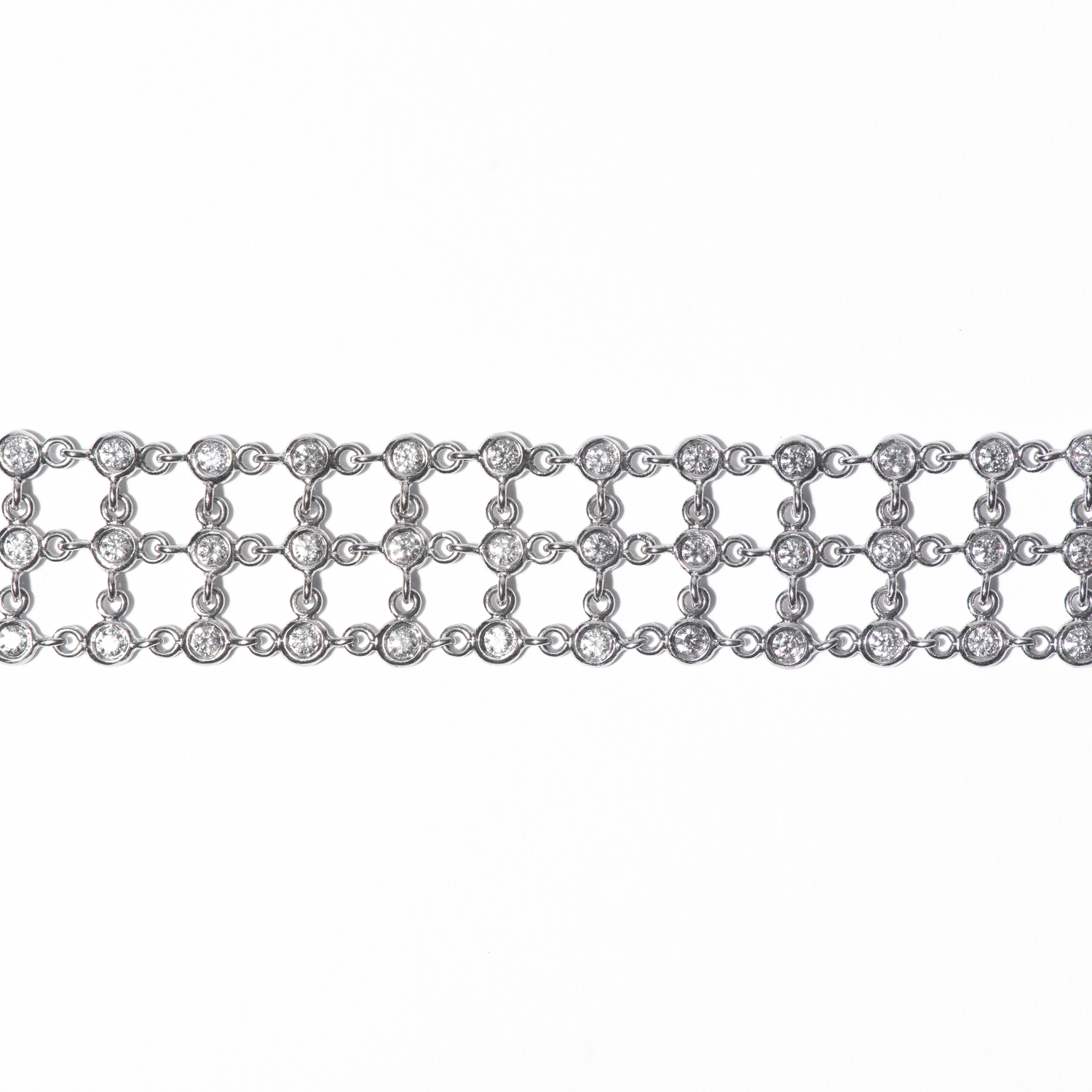 Design Ten. - 18K White Gold 3 Row Bezel Set Diamond Bracelet.