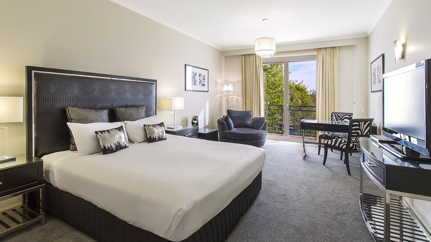 Executive King - 1 x KING BED • MAX 2 GUESTSA hotel room with a premium king bed, elegant furnishings and a private ensuite.