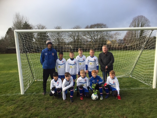 Pictured: Croft Red Under 11's with Team Coach/Manager Alex Sherriffs (left) and Nortim Precision Engineering Owner/MD Tony Powell (right)