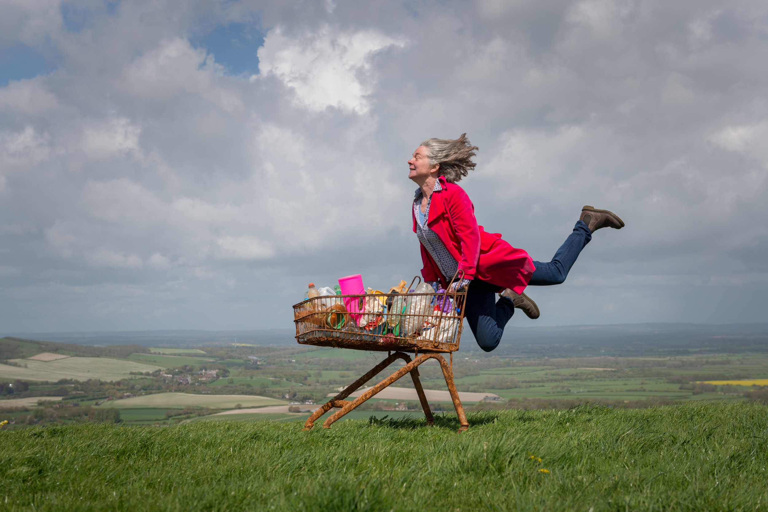 Louise McCurdy with her shopping trolley of beach plastic on Firle Beacon