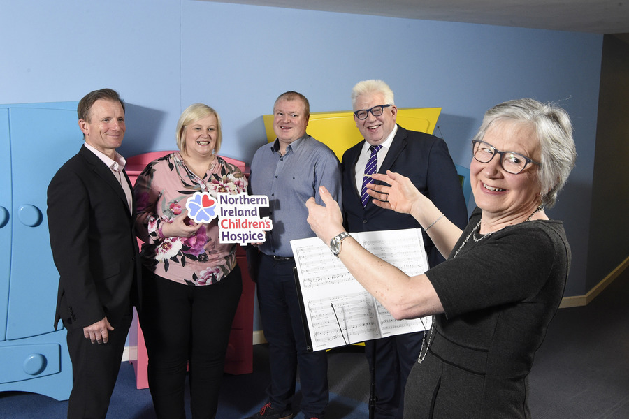 Audrey Gillian, Musical Director, Peter Russell (l) and Noel Brady (r), committee members of the Lagan Seahorses Male Voice Choir, share a vocal session with Heather Weir, CEO Northern Ireland Hospice and Paddy O'Hagan, COO of Neueda to launch their fundraising event on 8 June at the Waterfront Hall Complex.