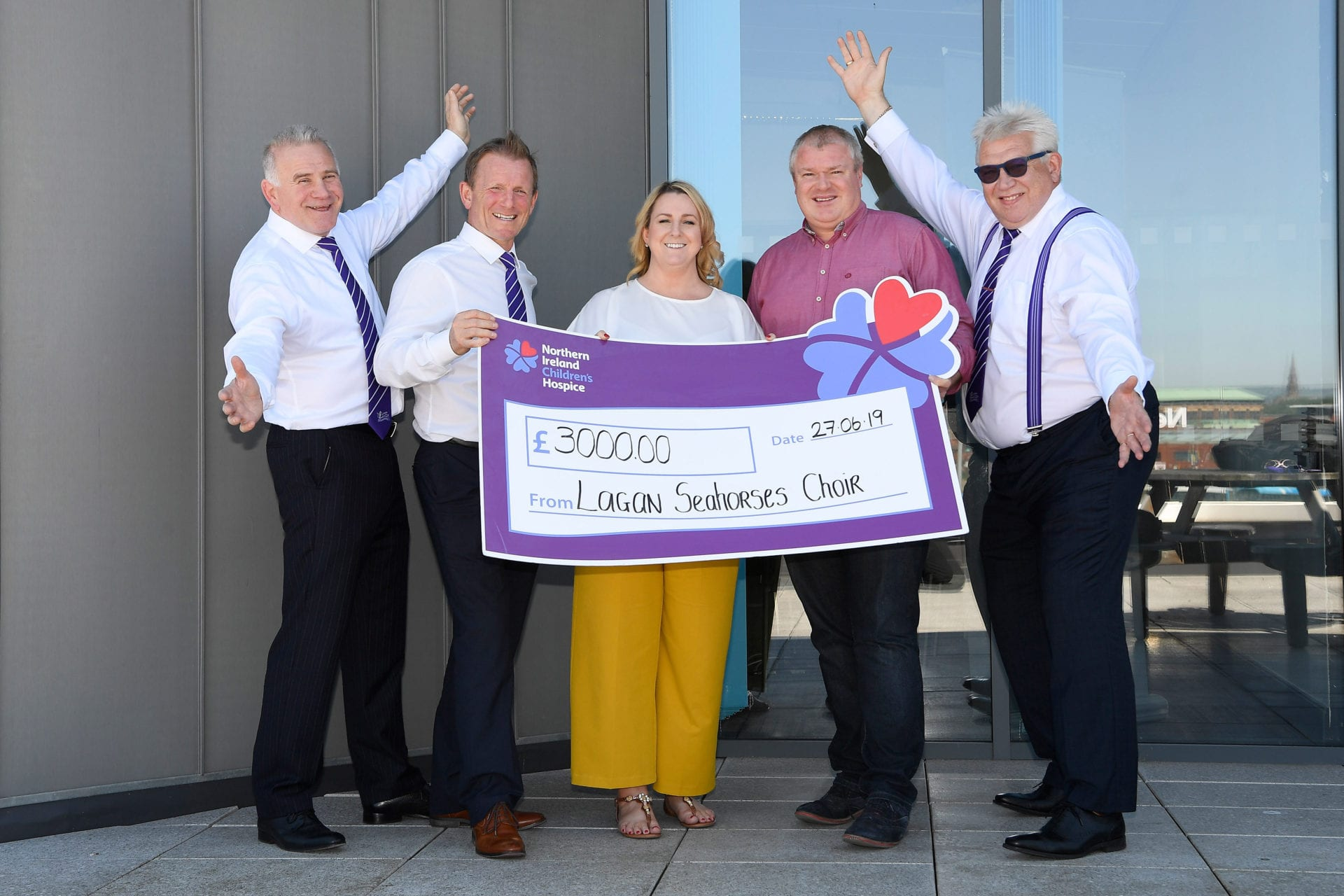 Pictured at the cheque presentation are (from l-r): Paul Hart, Treasurer, Lagan Seahorses, Peter Russell, Lagan Seahorses, Lauren Doherty, Head of Marketing, NI Hospice, Paddy O'Hagan, Neueda COO and Noel Brady, Lagan Seahorses.