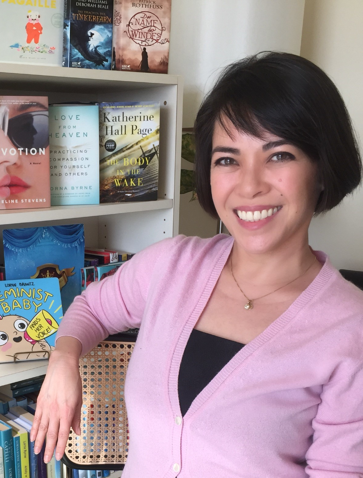 Stefanie Diaz, photo with books.png