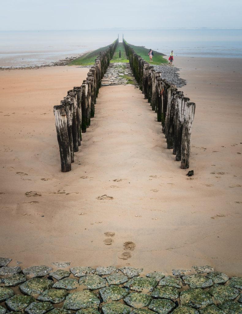 Netherlands-zeeland-beach-pillars-with-people-790x1024.jpg