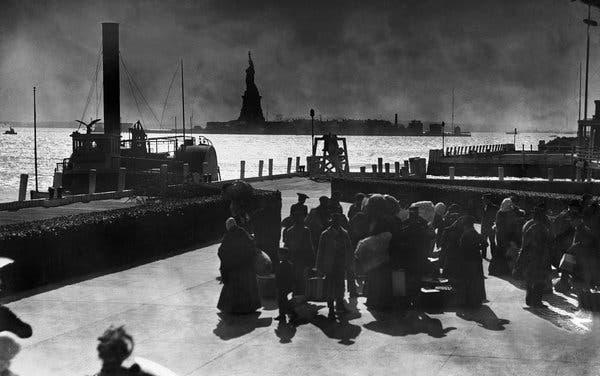Immigrants on Ellis Island circa 1900. (Getty Images)