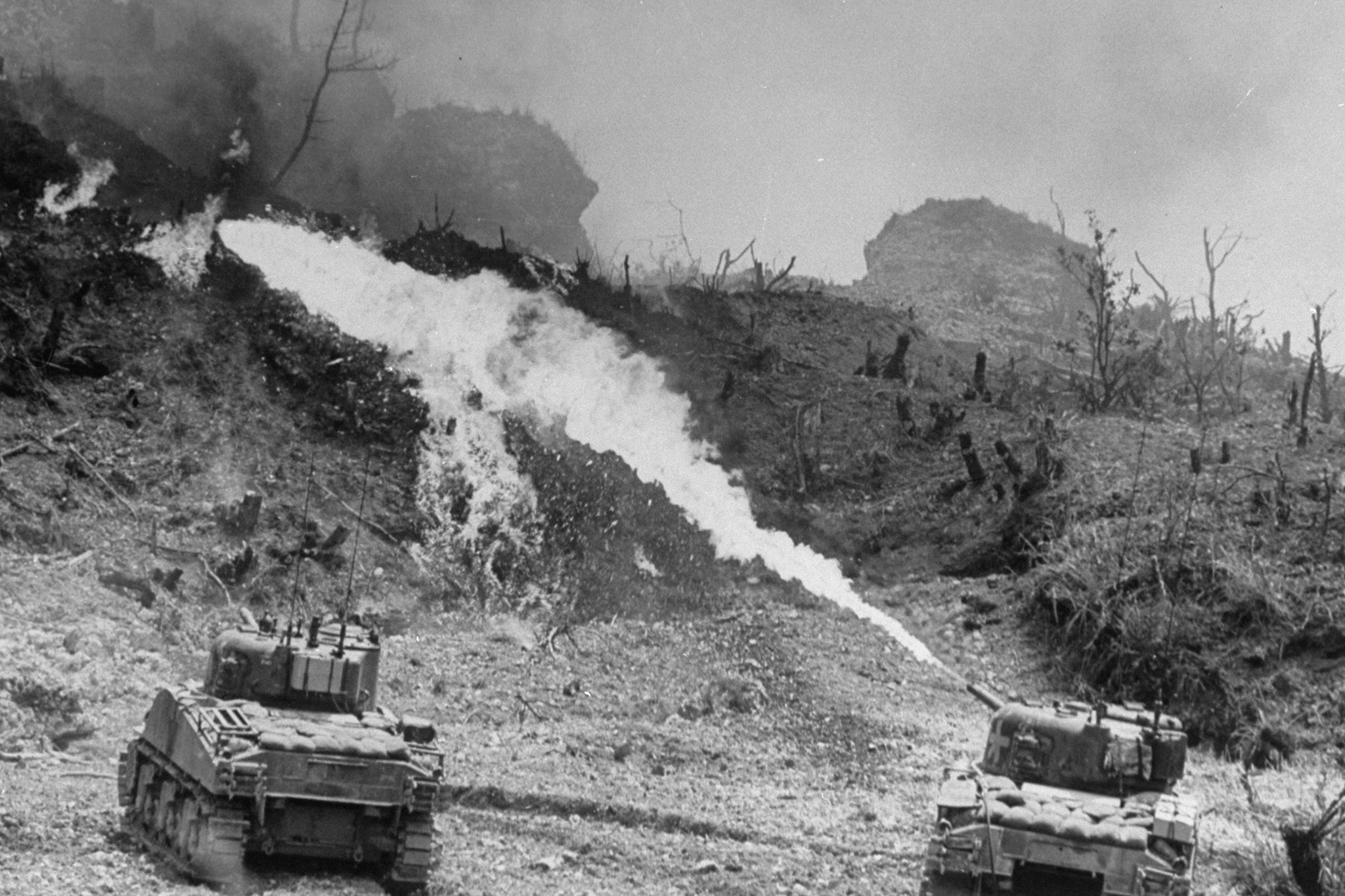 American tanks of the Army 7th Division using specially equipped flame throwers to burn Japanese defenders out of their caves and pillboxes, Okinawa, 1945. (Getty Images)