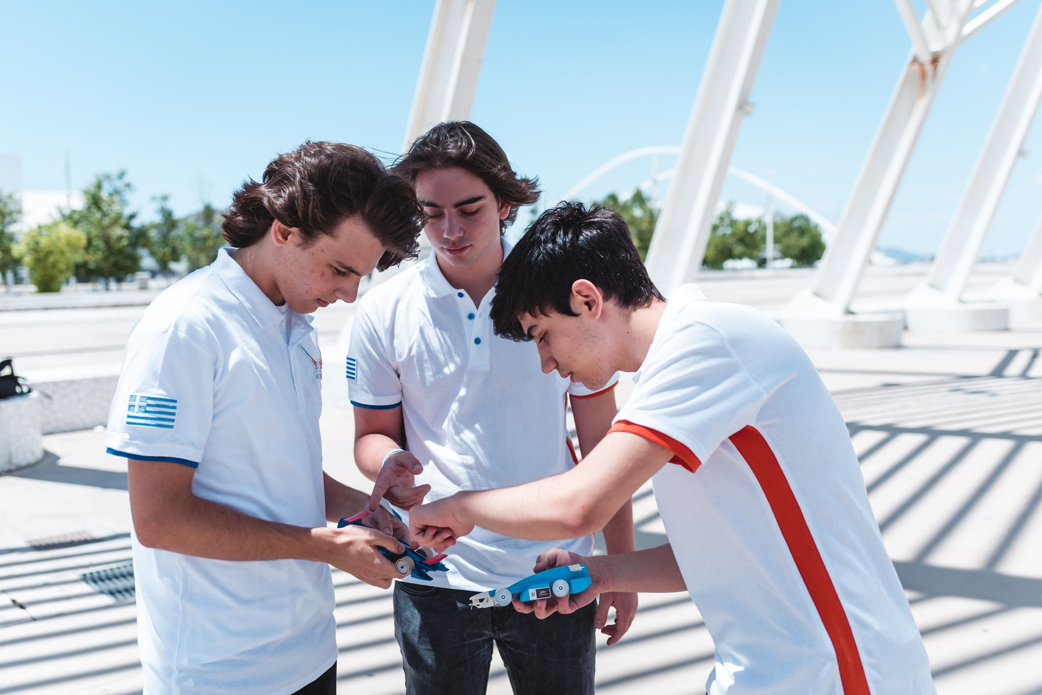Who we are - AlacrityDynamics is a team created by the AlimoDynamics from the 2nd High School of Alimos and the Alacrity Team from the Erasmios Greek And German School that participates in the 2019 Finals of the F1 in Schools contest. Our team consists of 8 basic and 13 supportive members from Greece. Collaboration, dedication and innovation are the three elements that deifne our team.