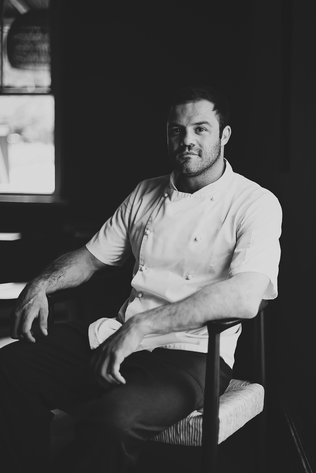 Chef Patron David Schneider - 'I want the diner to feel like they are at home. Maison means home, and I expect that level of comfort here, kick off your shoes and dine outside, sharing plates, drinking wine, and watching the world go by while being serenaded by chickens.We are here on a working farm, so you will feel what it's like to be here among us while dining right next to our kitchen at the foot of the Franschhoek mountains. My food isn't fancy, but it is a new type of luxury — fresh, sustainable, exciting new varieties and right out of the garden this morning. Our menu changes as seasonal ingredients do. We flow with the rhythms of nature and by the butcher's recommendation of alternative cuts of meat, and what the fishermen caught today. Our food is comforting and balanced, yet unrefined in its presentation. We don't want to feel polished, but rather a bit rough around the edges.'