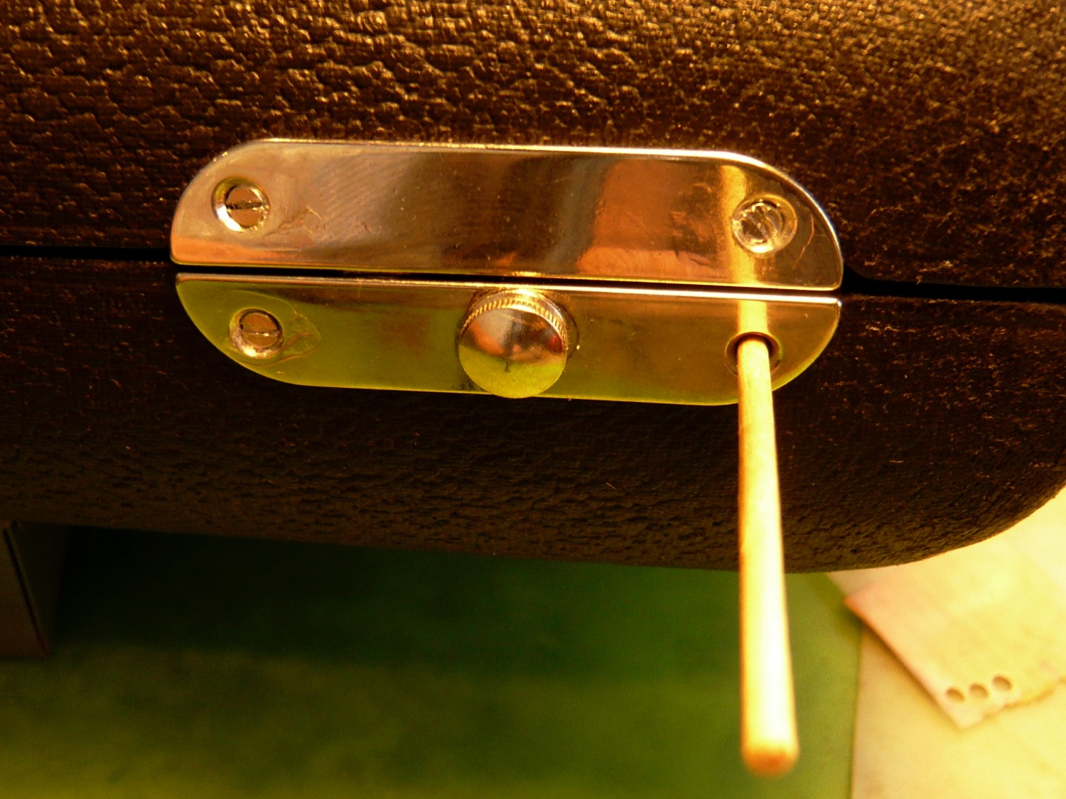 Take a toothpick or skewer and blunt the end. Then insert it into the hole as shown and break it off.