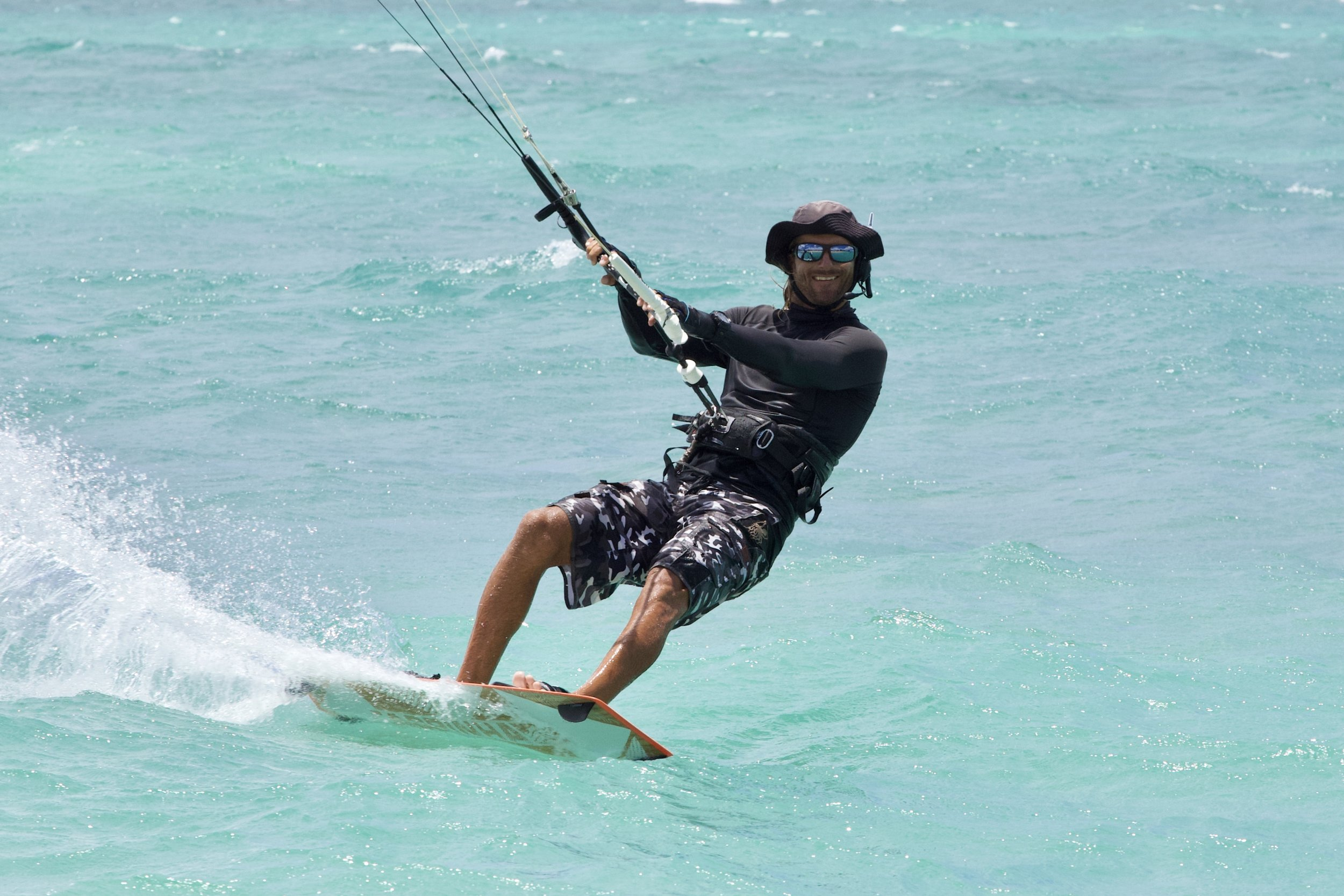 Experience the fun of kitesurfing, smiles for miles guaranteed!