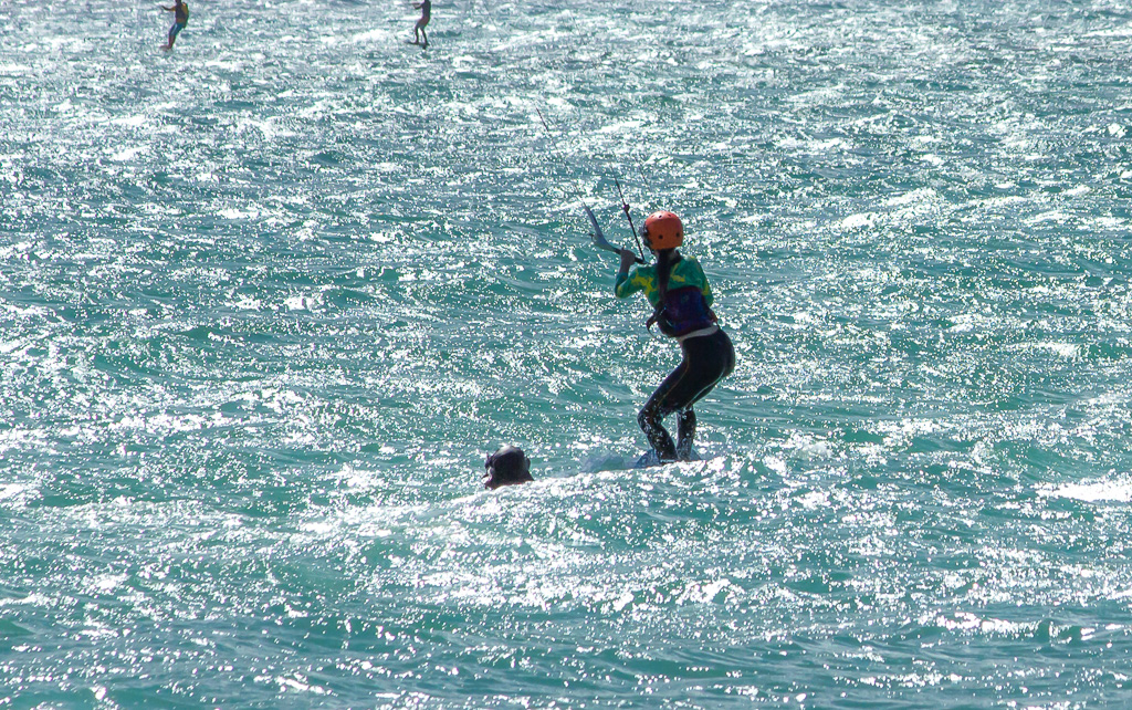 There's Tahiti kiting during her first lesson with Brett right next to her in the water showing the way!