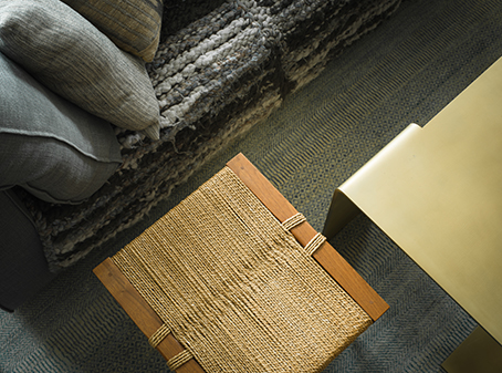 Various textures of couch, stool, coffee table