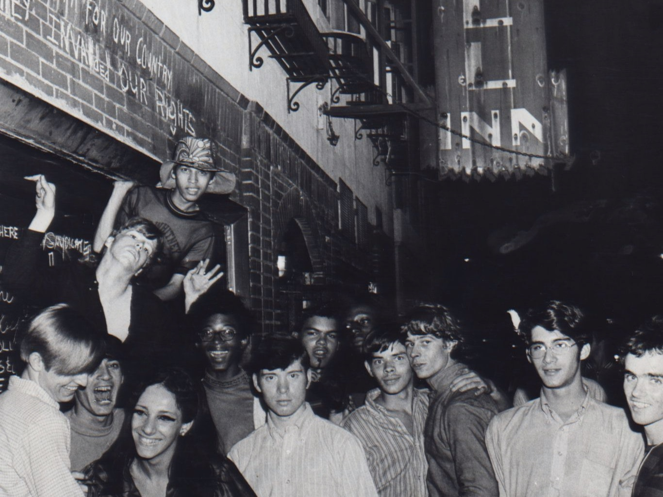 Unidentified young people celebrate outside of the Stonewall Inn (53 Christopher Street), after the riots, 1969. By Fred W. McDarrah/Getty Images.