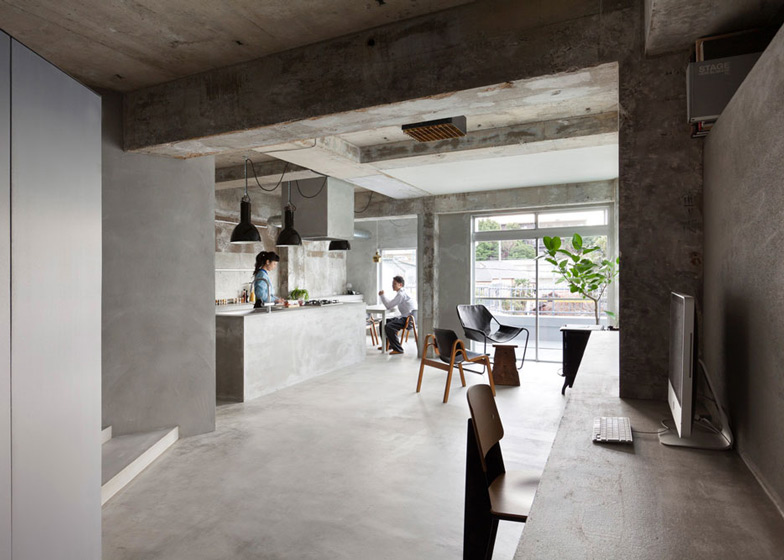 Bare-concrete-apartment-by-Airhouse-Design-Office-presents-its-own-fashion-exhibitions_dezeen_ss_2.jpg
