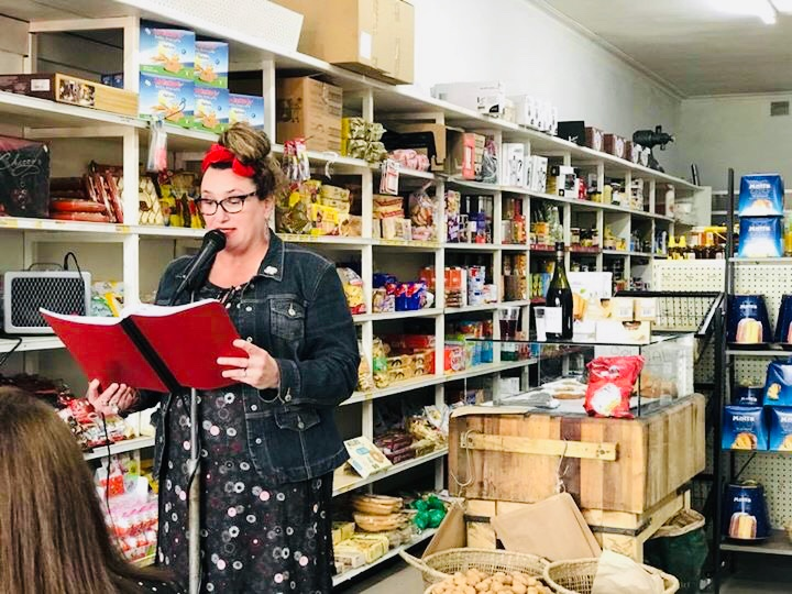 Reading excerpts of 'Lifting the Lid' in place at Rocco's Delicatessan, Yarraville