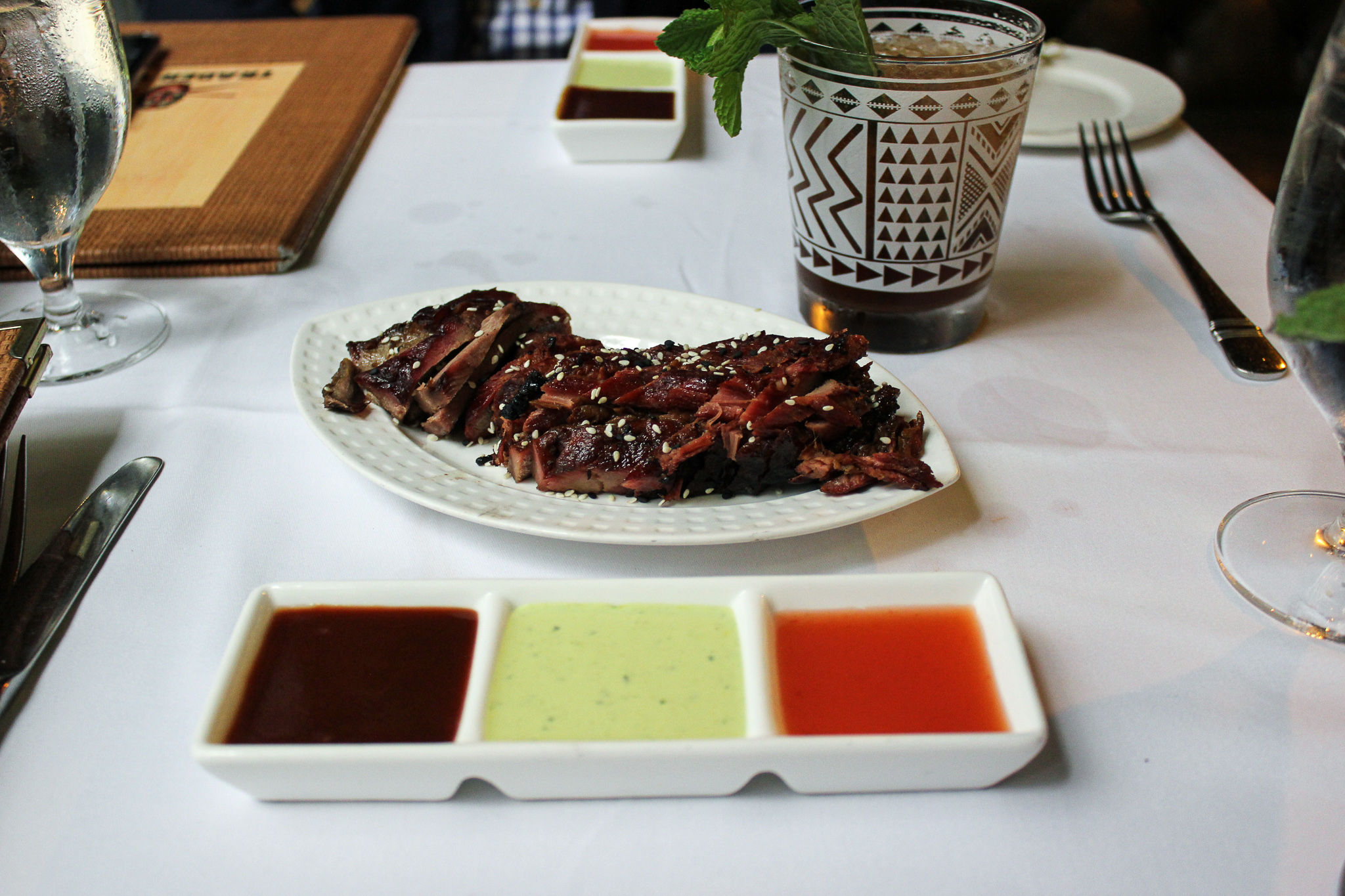 Trader Vic's Cha Siu pork with a trio of dipping sauces (c) Anna Lanfreschi