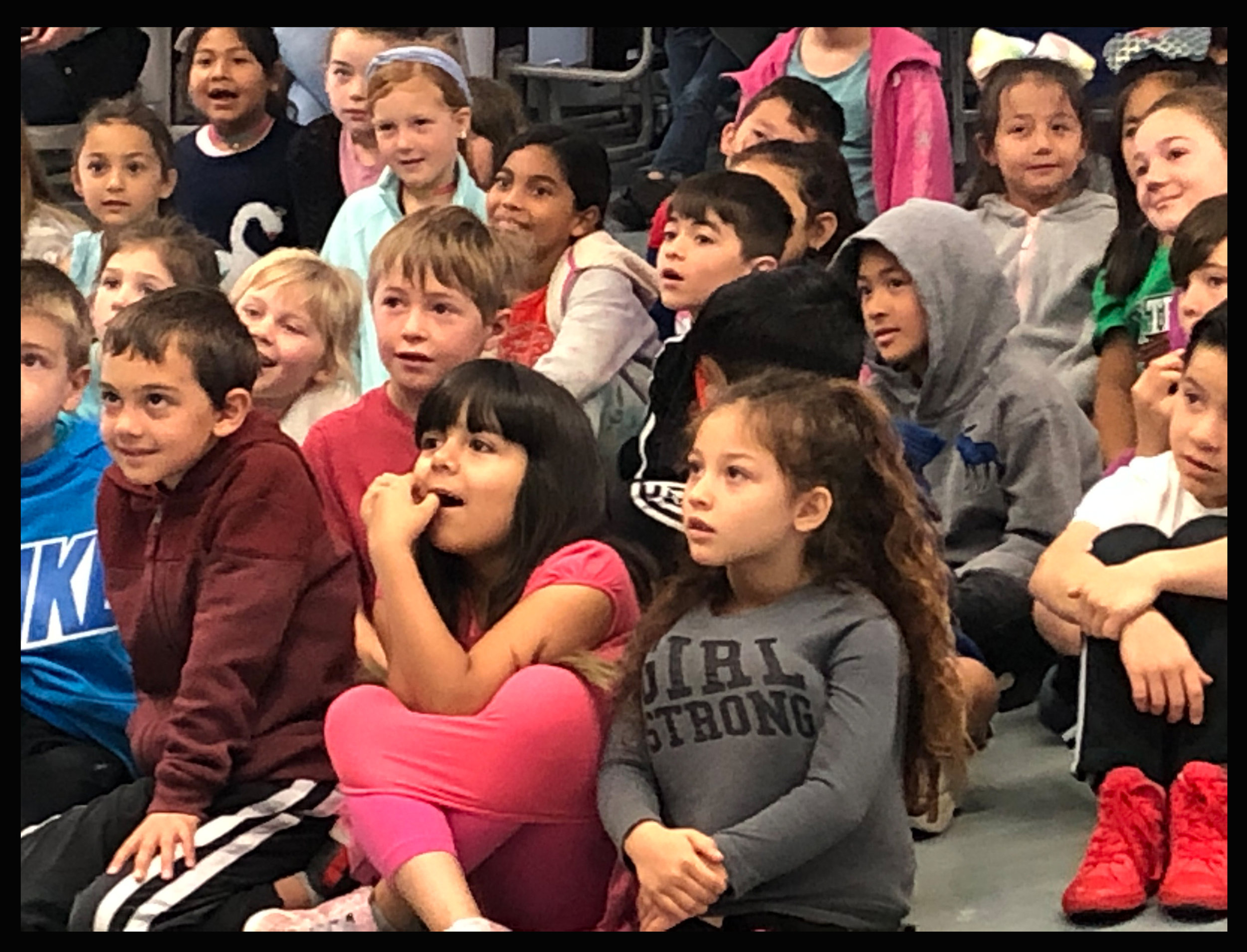Elementary school students, each and every one captivated by a visiting author. 2019
