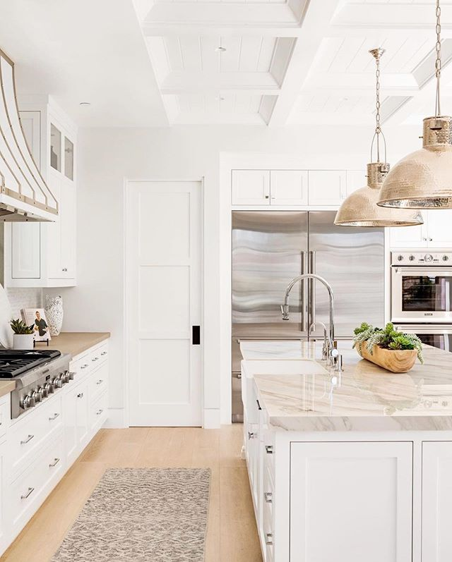 Heading into the week and things are looking very bright, including this kitchen we can't take our eyes off! - P.S. Stay tuned tomorrow for a very special #mackenzieco announcement! You certainly aren't going to want to miss this 😊 - 📸 @chadmellon @churchill_design @pattersoncustomhomes #interiordesigngoals #homeinspo #whitekitchen #lightandbright #brightandwhite #whitecabinets #doingneutralright #howihome  #sodomino #smploves #dailydecordetail #homestyling #myhouseandhome #thethoughtfullylayeredhome #loveinteriors #decorgoals #interior123 #fromwhereistand #bostoninteriordesigner #capecodinteriordesigner #interiordesignlifestyle #charlestonscinteriors #interiortrends #designtrends2019 #freshinteriors #plantsinthehome  #serenaandlily #neutralhome