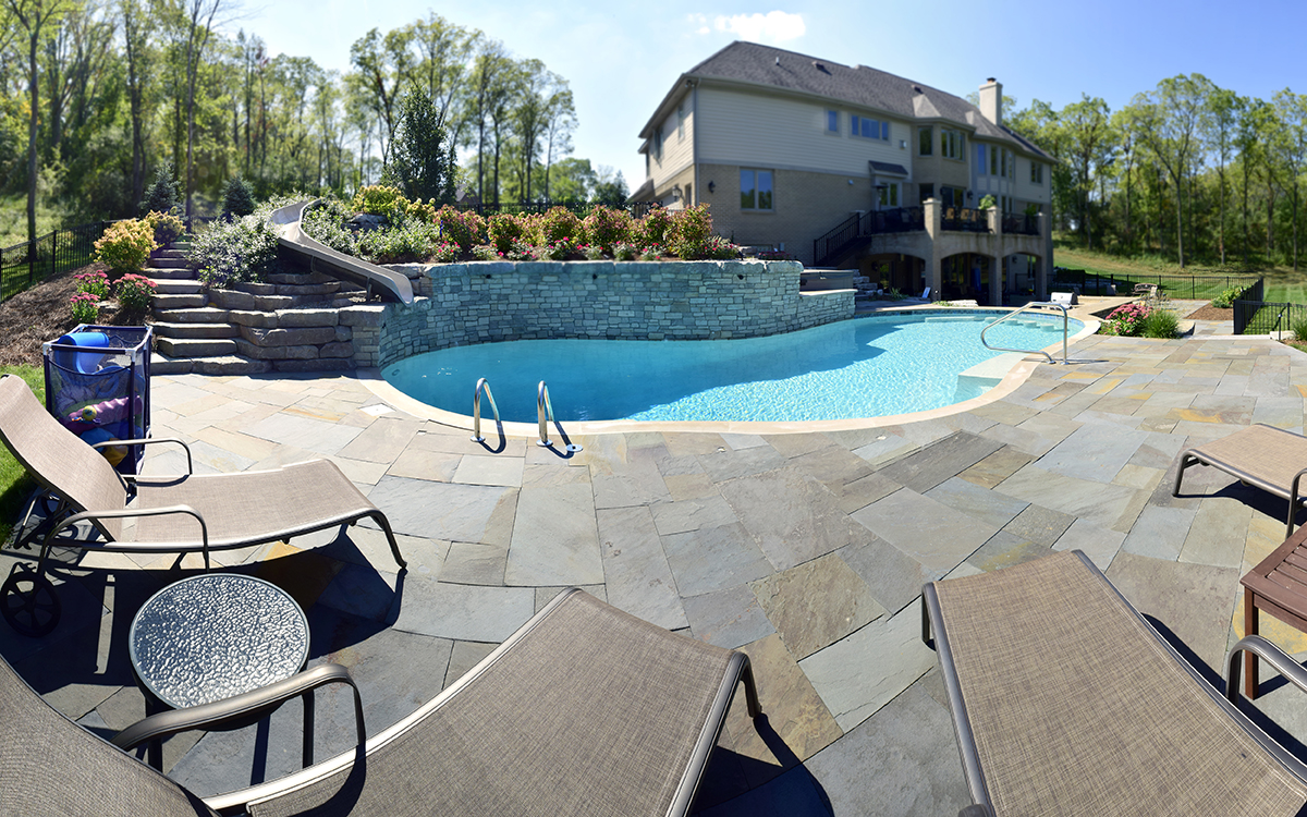 Top landscape design in Brighton MI - pool with outdoor fireplace