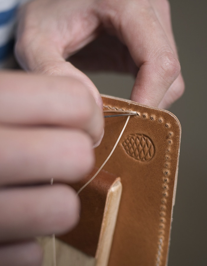 Flat-Leather-wallets-hand-stitching-close-up©-The-Level-Collective.jpg