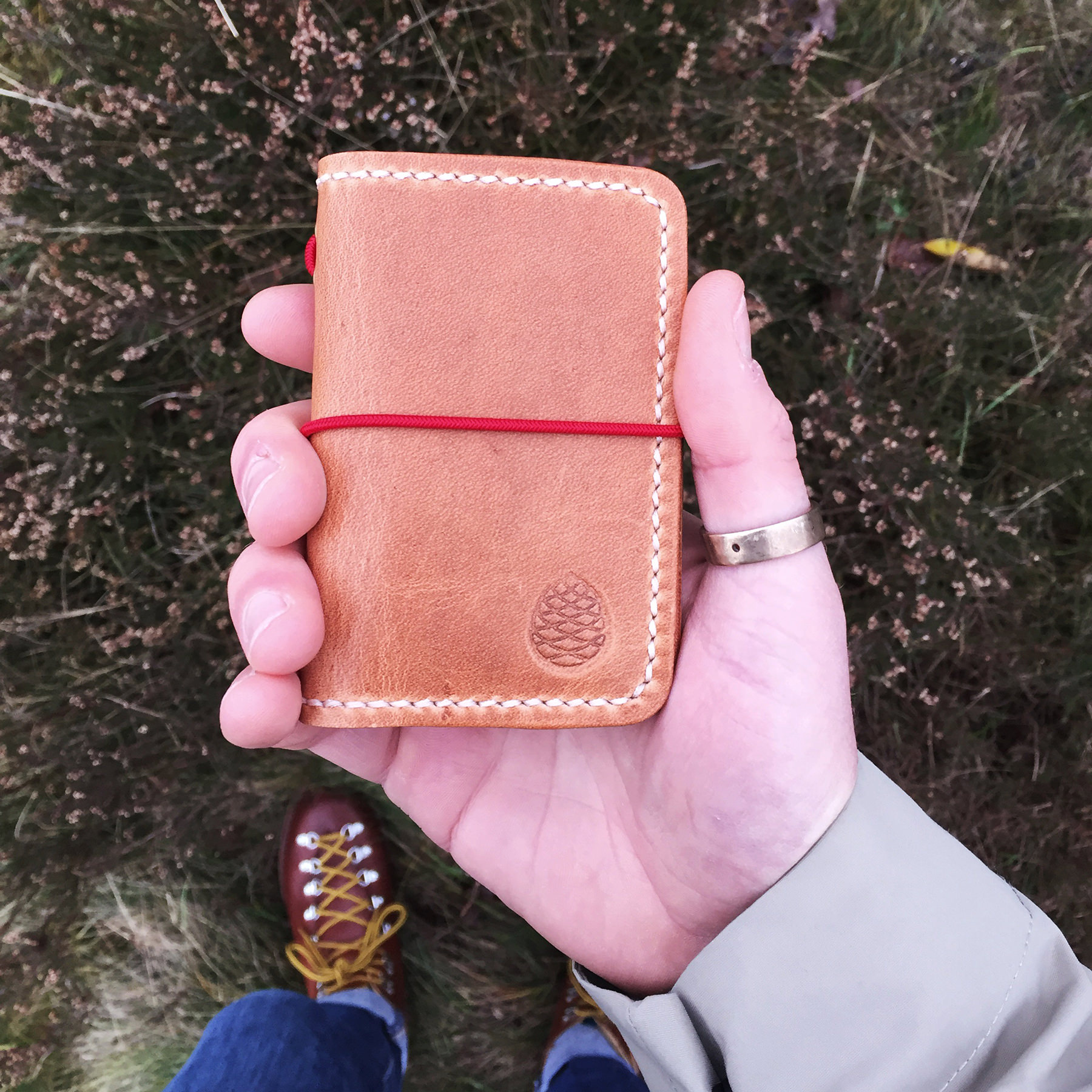 The-Level-Collective-tan-leather-wallet-hand.jpg