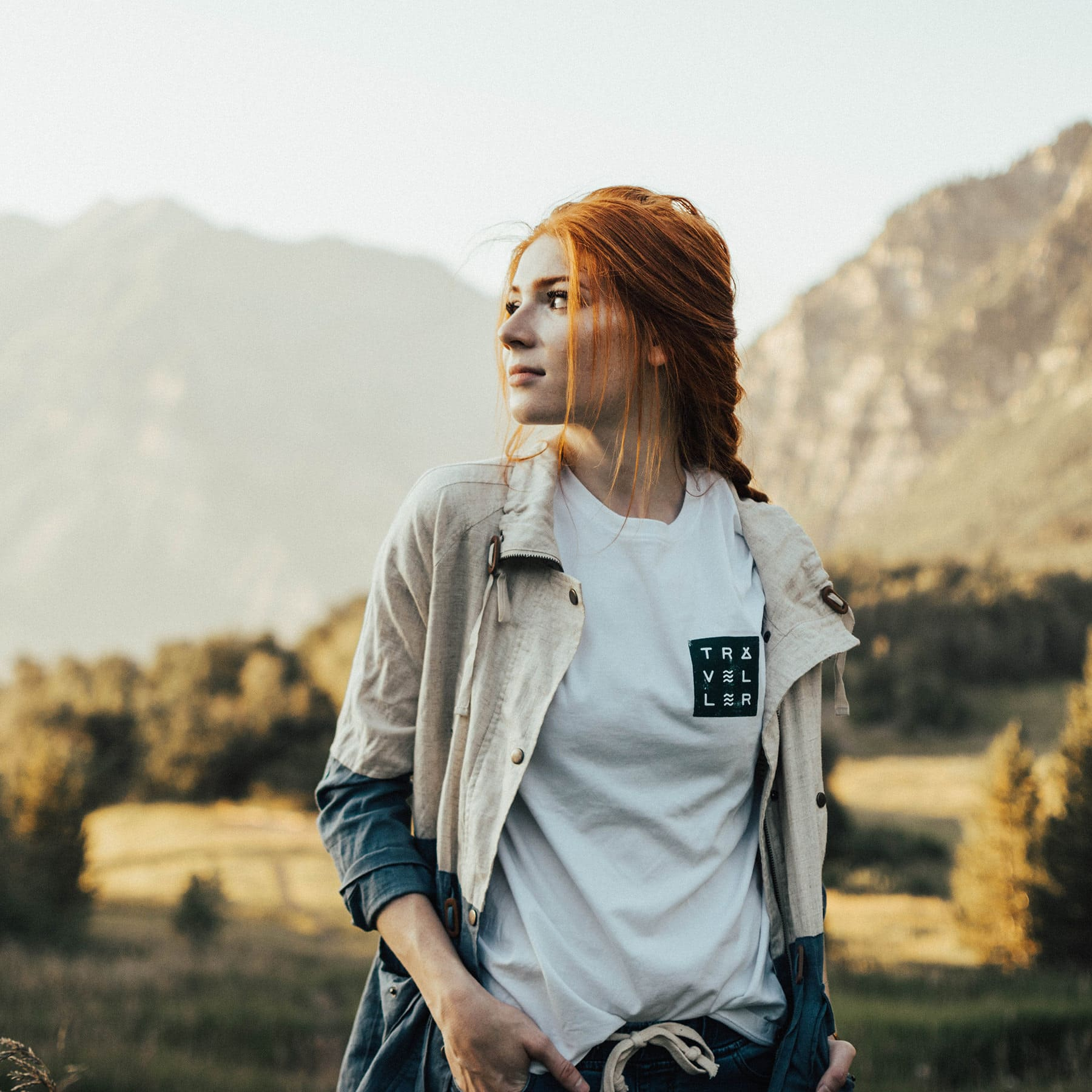 TRAVELLER-t-shirt-white-and-forest-front-©-THE-LEVEL-COLLECTIVE-.jpg