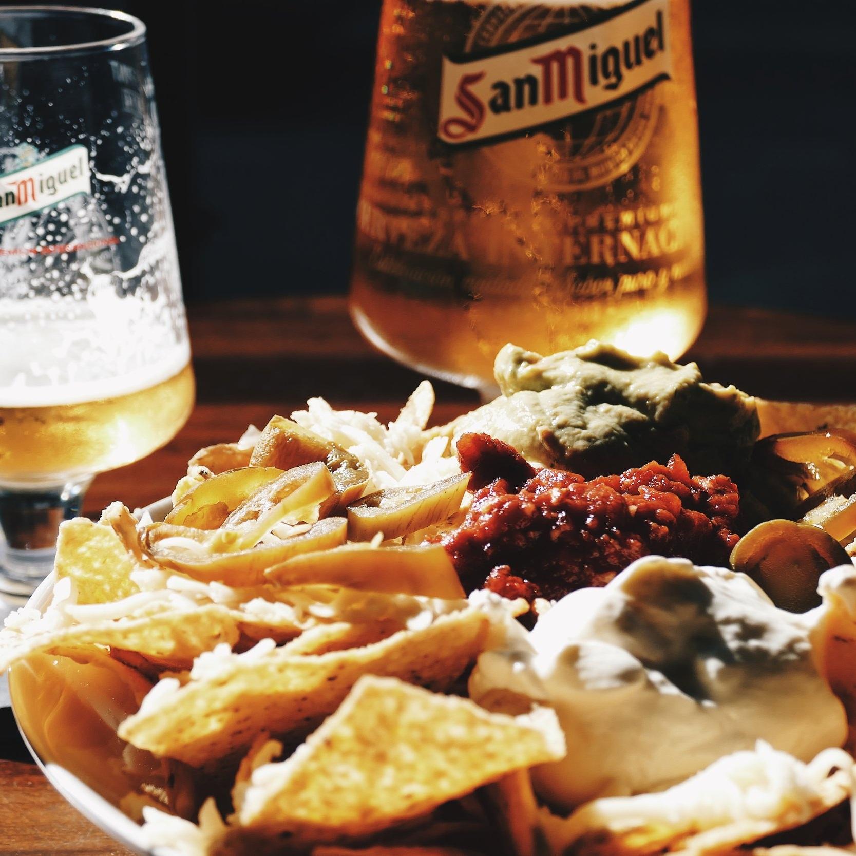 NACHOS - TORTILLA CHIPS | MOZZARELLA | SALSA | GUACAMOLE | SOUR CREAM. ADD JALAPENOS FOR A KICK!